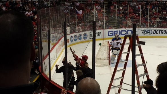 A pane of glass is replaced midway through a very physical game