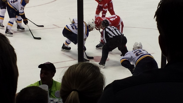 Joakim Anderson (18) faces off against David Backes (42)